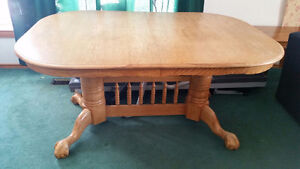 solid wood dinning table with four chairs