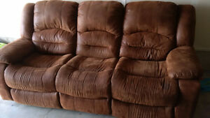 Reclining suede couch