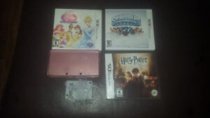 Pink nintendo 3ds with 3 games and charger