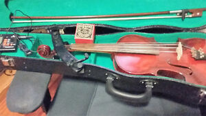 Older fiddle and Case, bow. tuner, shoulder rest, rosin.