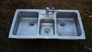 Large triple sink with faucet