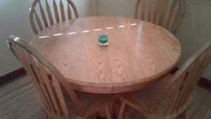 Kitchen table with 6 chairs and a leaf