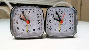 TWO portable battery operated alarm clock   $4 ea/BOTH for $7