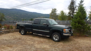 2003 GMC Sierra SLT 4x4, extended cab, long box.