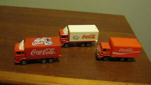 Lot of 3 miniature Coca-Cola delivery trucks - all different