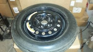 Spare Tire on rim, unused,  Off of a 2006 Nissan Altima Cornwall Ontario image 1