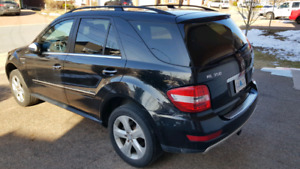 2010 Mercedes ML350  Too many options to list.  Firm
