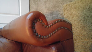 Leather love seats and Ottoman