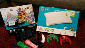 Wii U system, wii u fit, controllers, nunchuks, and games