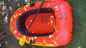 FREE (WITH PURCHASE) INFLATABLE BOAT AND PADDLE (SEE AD)