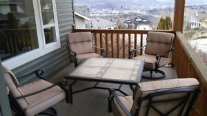 Tan Conversations Set - Tile table/cast chairs (swival) Like new
