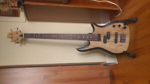 Hand finished 4 string bass guitar with EMG active pickups