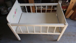 Vintage white solid wood Doll Bed with legs on metal casters