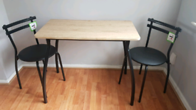 Brand new dining table and 2 chairs