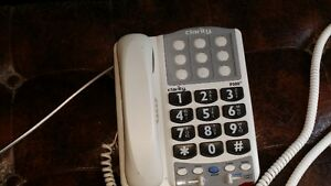 Telephone for hearing & sight impaired