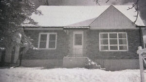 Single Family Home in Dobbin Ave