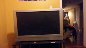 Panasonic 50 inch with make shift stand contact for info