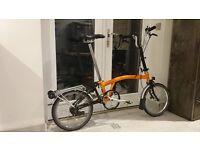 Brompton orange folding bike