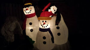 I'm selling a large Christmas blow-up decoration with 3 Snowman'