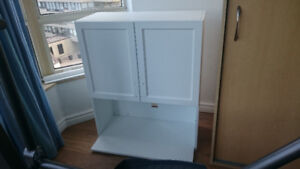 white microwave cabinet