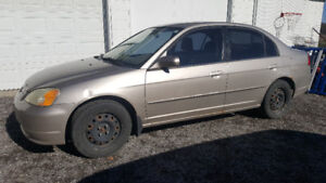 2002 Honda Civic  with an extra set of winter tires on rims