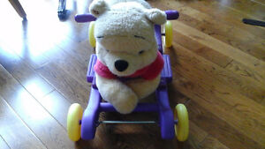 Rock 'n' Roll Ride-on plush Winnie the Pooh with music!