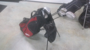 Full set of Wilson golf clubs with bag.