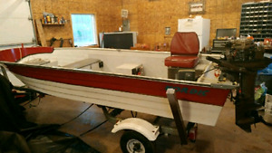 14'Nordic fishing boat with 30hp Suzuki motor, and trailer.