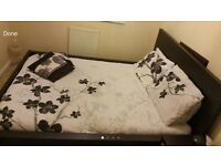 King Sized Bed with side table