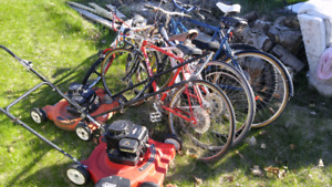 6 Bicycles and 2 lawn mowers $ 100
