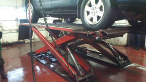 Wheeltronic garage lifts and air compressor