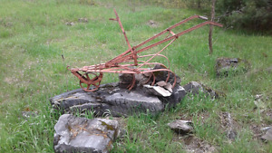 Yard art old plow i have a couple sold with the rock or not