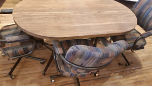 Table and 4 chairs from benits new condition