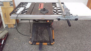 Craftsman cast table saw.