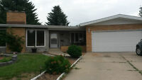 Rare find... Beautiful bungalow, 2 garages, pie shaped lot