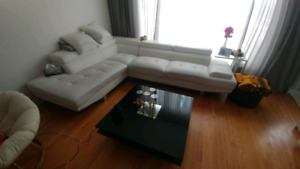 $200 White leather sectional sofa + $150 coffee table