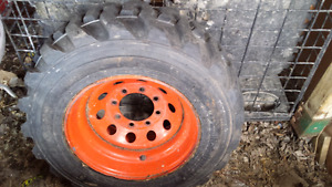 Almost New Skid Steer Tire and Rim Set 10-16.5 Tire