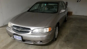 2000 Nissan Altima GXE .  160k .  Very good condition.