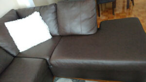Brown bounded leather sectional