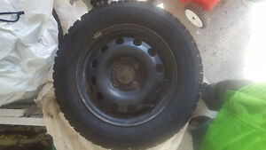 Four 14 in Winter tires and rims used only 1 season