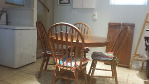 Solid wood dining room table with two leaves and six chairs