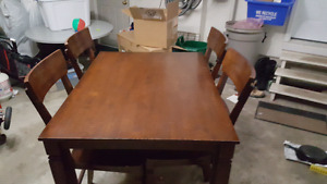 "48"" by 36"" dinning room table with 4 chairs."