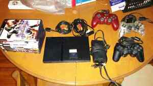 Ps2 slim with 3 controllers and 7 games.
