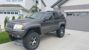 Lifted overland jeep grand Cherokee.Blown bottom end
