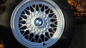 (4 )BMW 15inch , 5 hole, series 3 rims and so so tires