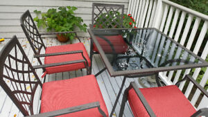 Patio set- table with 4 chairs and cushions