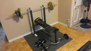 Used benchpress set with 150lbs of weights