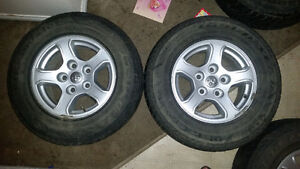 4 Dodge 5 bolt Rims with Goodyear UltraGrip WRT tires