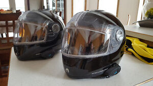 Pair of CanAm motorcycle helmets with communicators