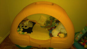 Little yellow toddler car bed with crib matress
